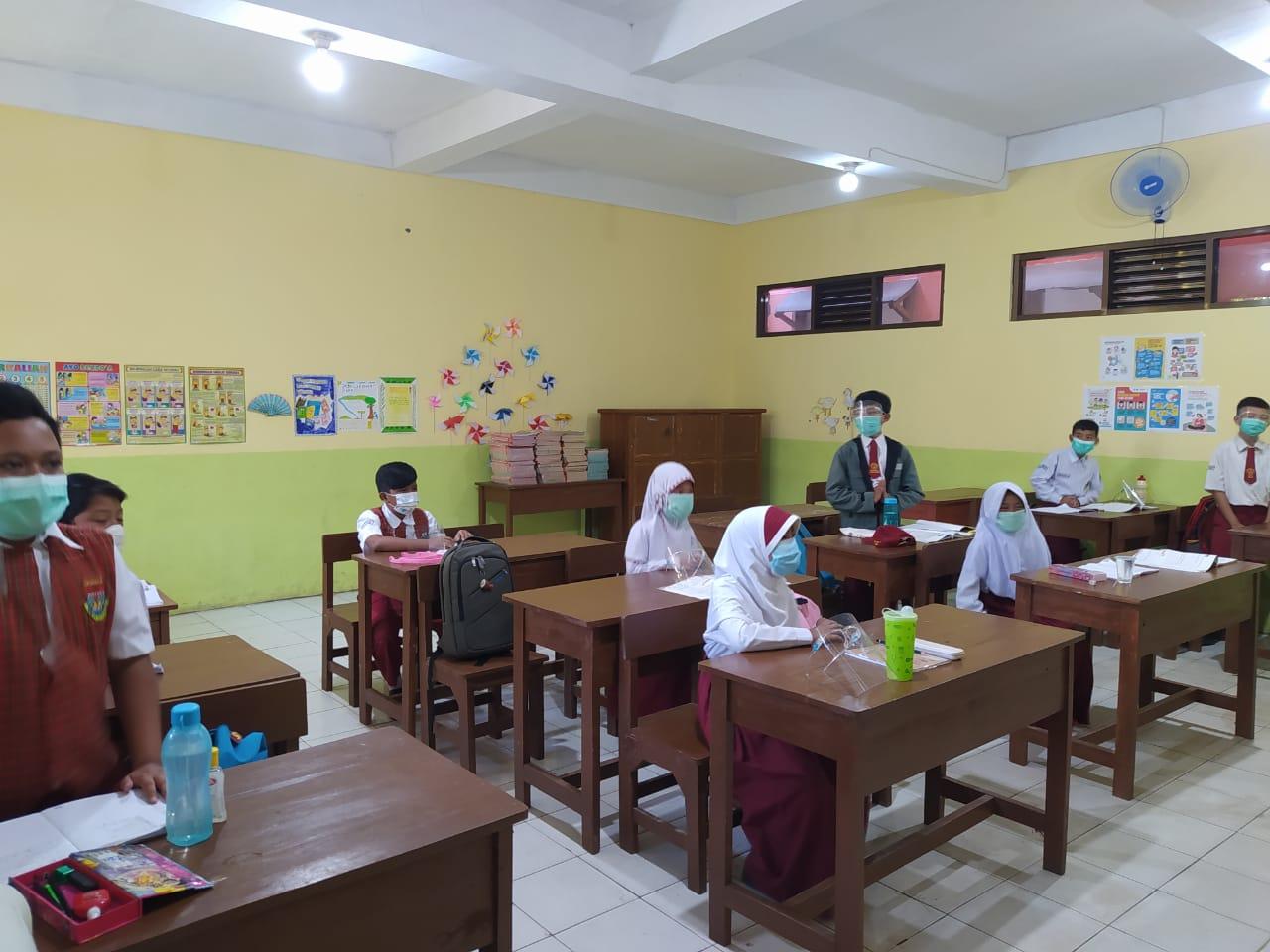 ILUSTRASI: Sejumlah siswa melaksanakan pembelajaran tatap muka.